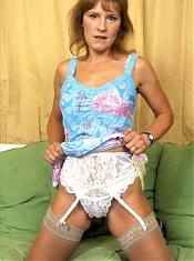 Hot MILF shows her stocking covered legs